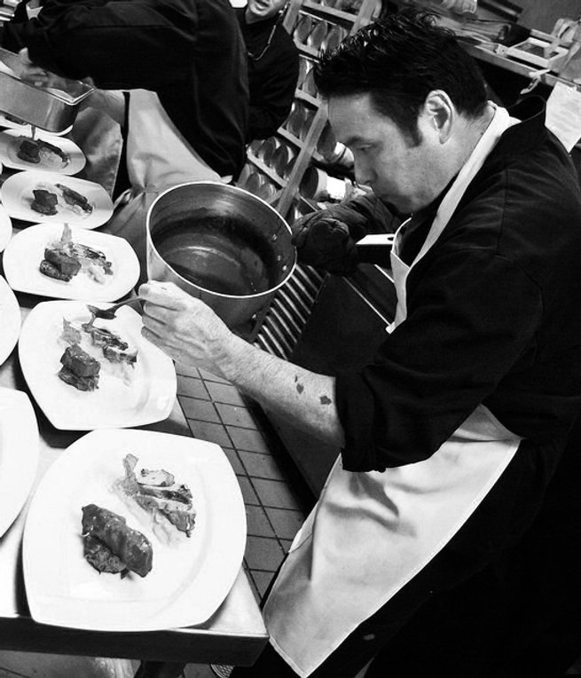 Chef Robin Higa putting the final touches on a VIP Meal