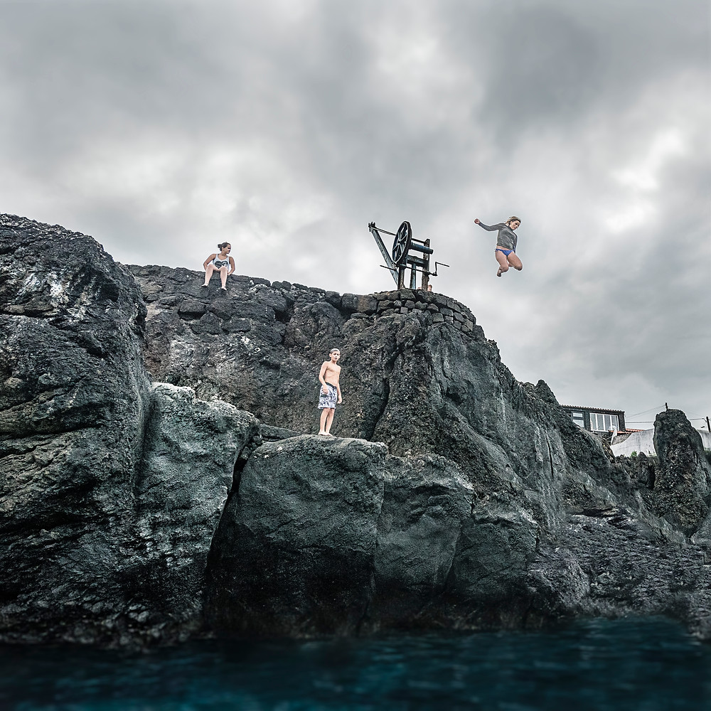 Maaike jumping with locals somewhere on Pico island