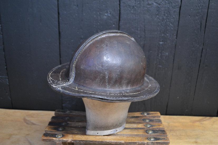 Antique leather miners helmet