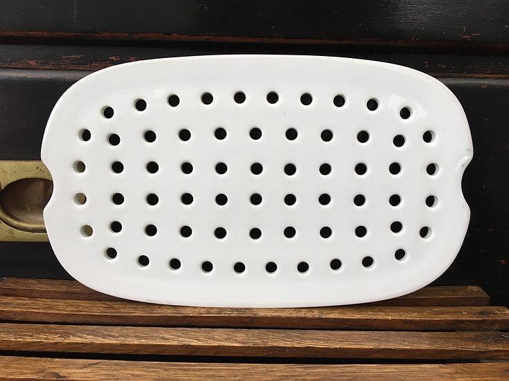 White porcelain oval drainer plate