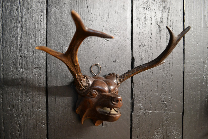 Antique carved deers head
