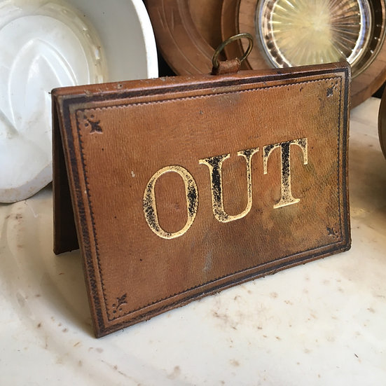 Antique leather IN/OUT sign