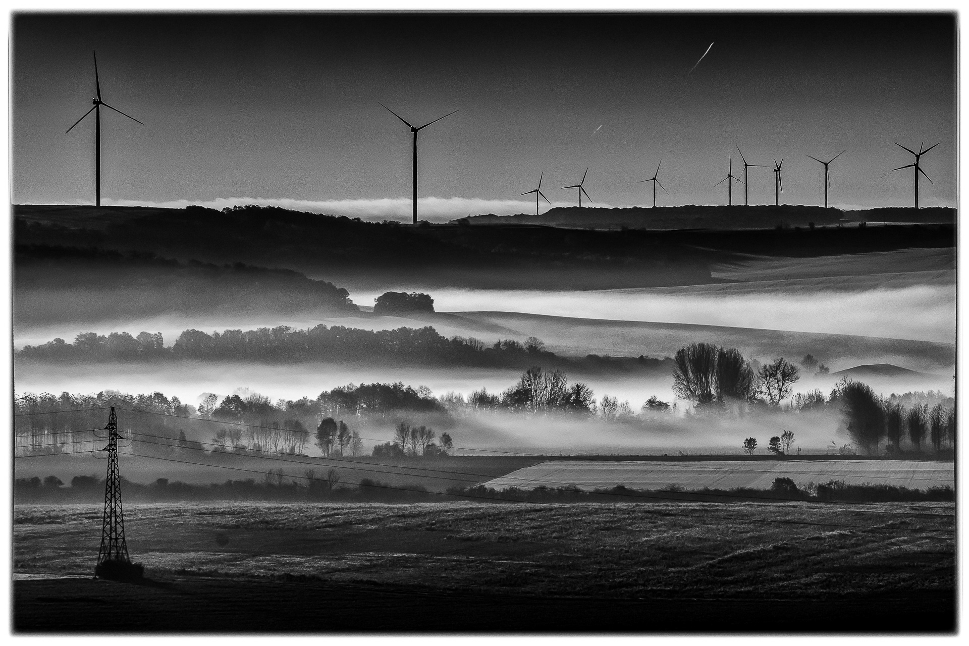 Windmills in the Fog