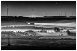 Windmills in the Fog