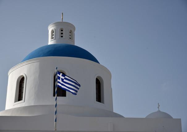 Santorini-blue-dome-Greek-flag-The-Greek