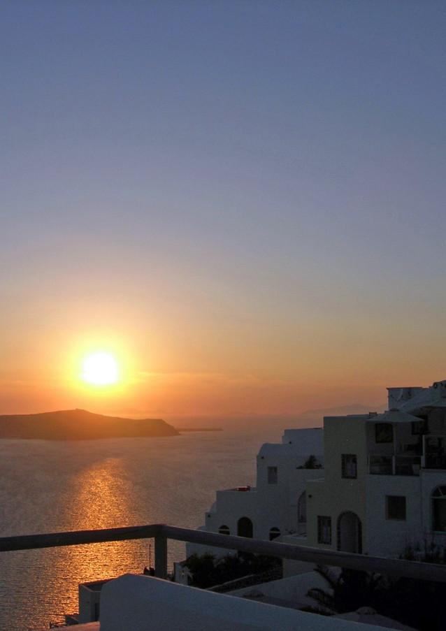 Santorini-sunset-over-caldera-The-Grekis