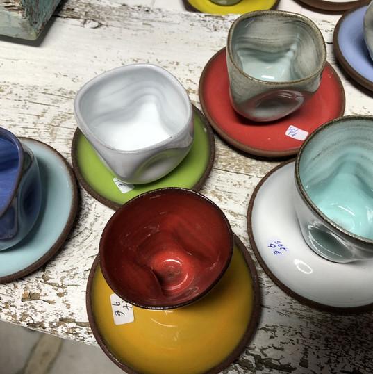 Handmade coffee cups and saucers.
