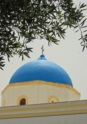 Santorini-blue-dome-with-tree-The-Greeki