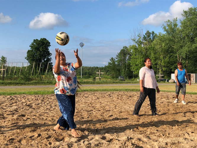 Deaf New Americans take a break from farming to play some volleyball.