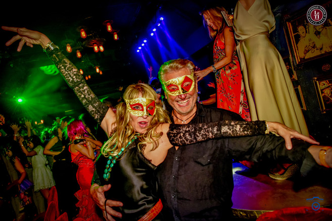 Fancy dresses & golden masks! Credit pho