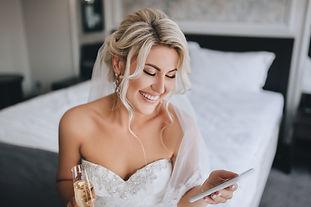 A beautiful, smiling blonde bride in a w