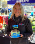 Sandy with RSPCA 40th Birthday celebration cake donated by Sandys Grooming Tails K9 Cafe