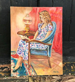 Portrait painting of a seated woman