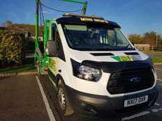 Skip Towing Van | Parked Van | ATS Skip Hire