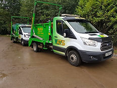 Parked Skip Vans | Green and Yellow Vans | ATS Skip Hire