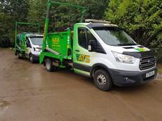 Parked Skip Vans | Green and Yellow Vans | ATS Skip Hire