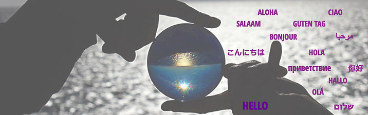 "There are two hands in silouette holding a clear acrylic contact juggling ball in front of a body of water. The light is behind the hands and an inverted image of sky and water show through the ball. There word ""hello"" is written in many different languages."