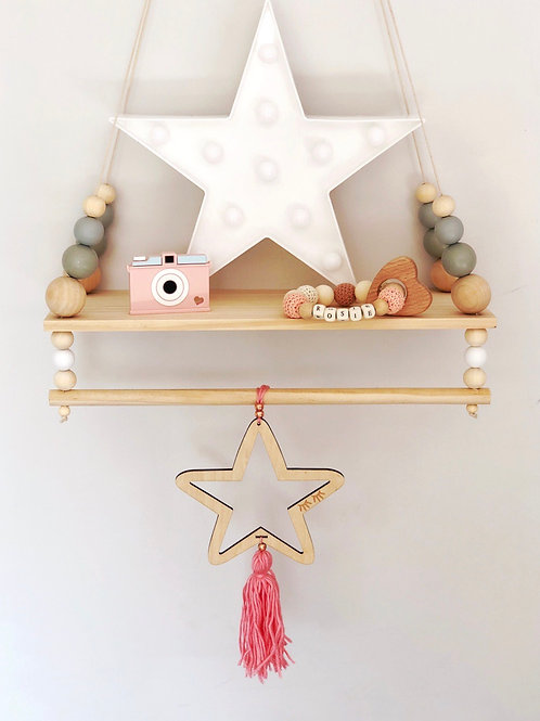 Wooden star with tassel decoration