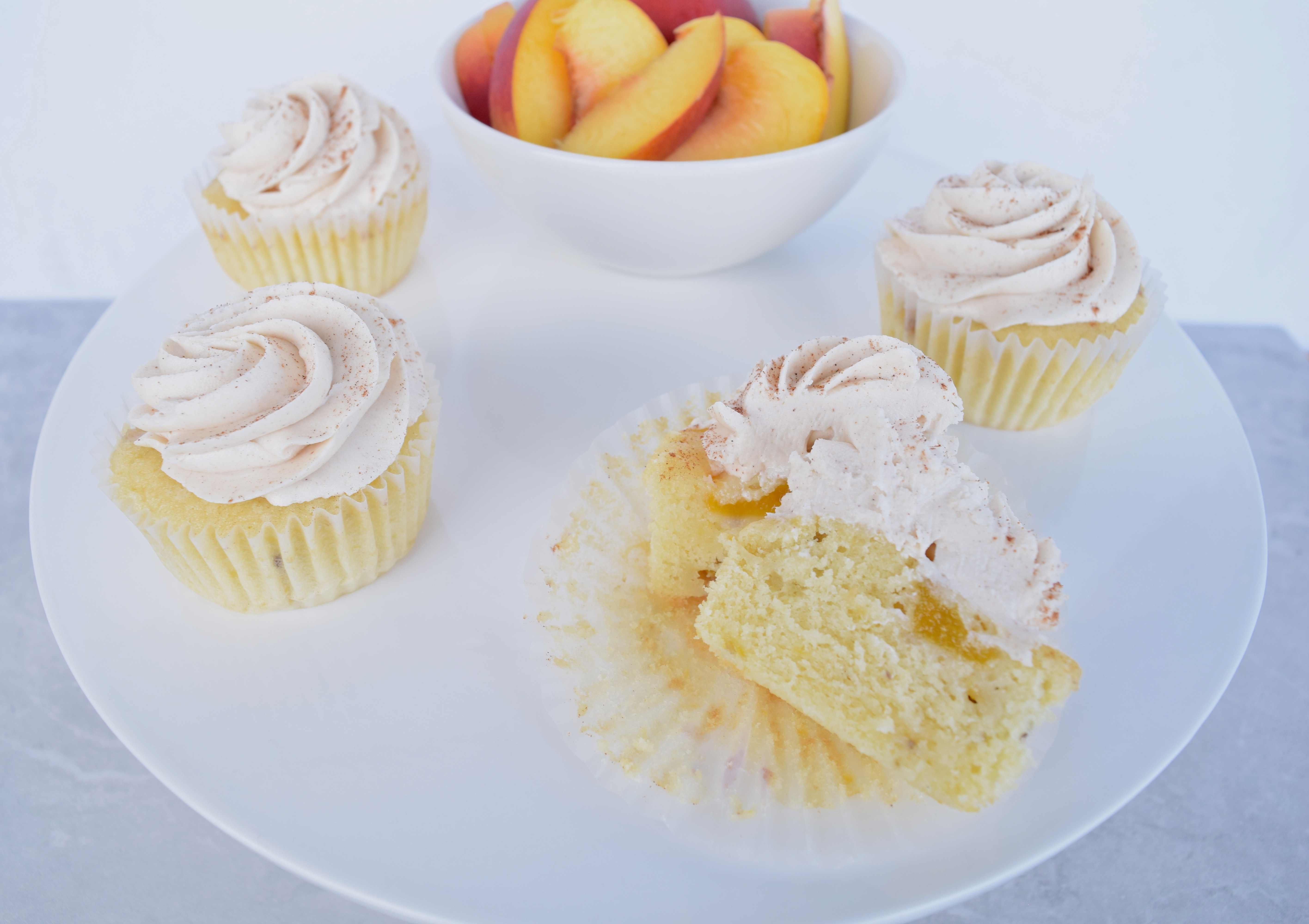 Peach cupcakes with spiced frosting
