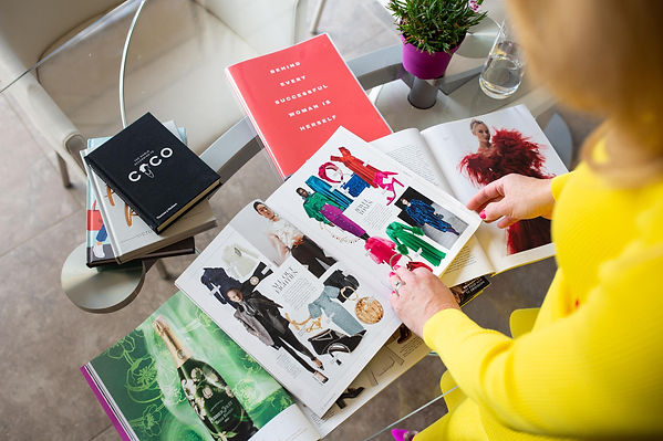 Lizzy looking at magazines of bright clothes
