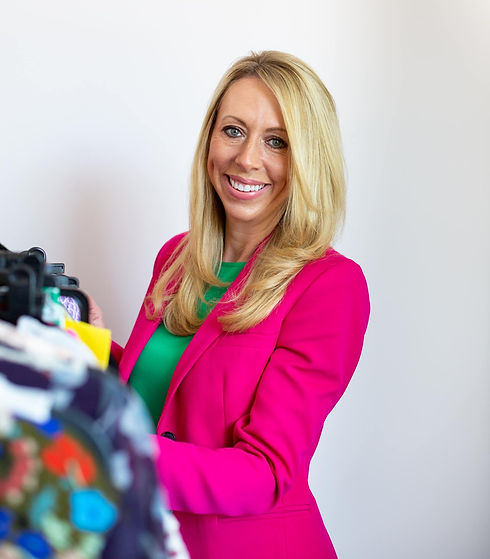 Lizzy smiling looking through clothes