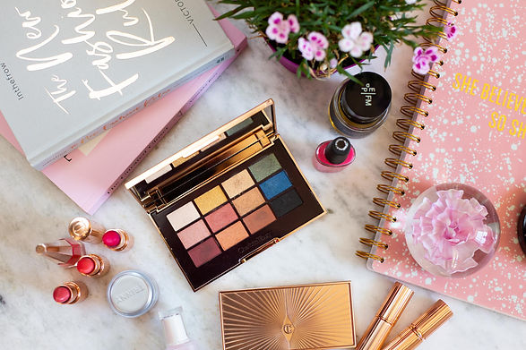 Flat lay of Lizzy's makeup and books