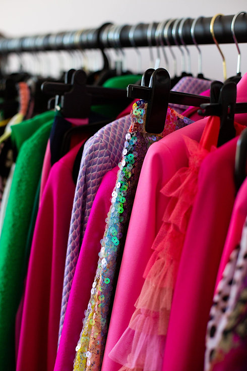 Brightly coloured clothes on a rack