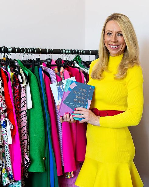Lizzy holding fashion books