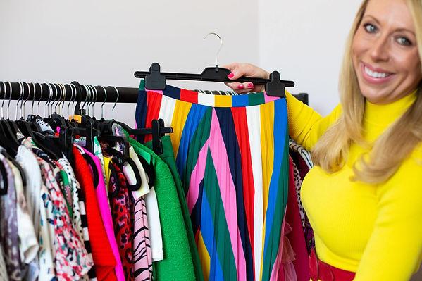 Lizzy holding a rainbow coloured skirt
