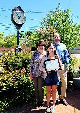 Emma Olshin with parentsfx.jpg