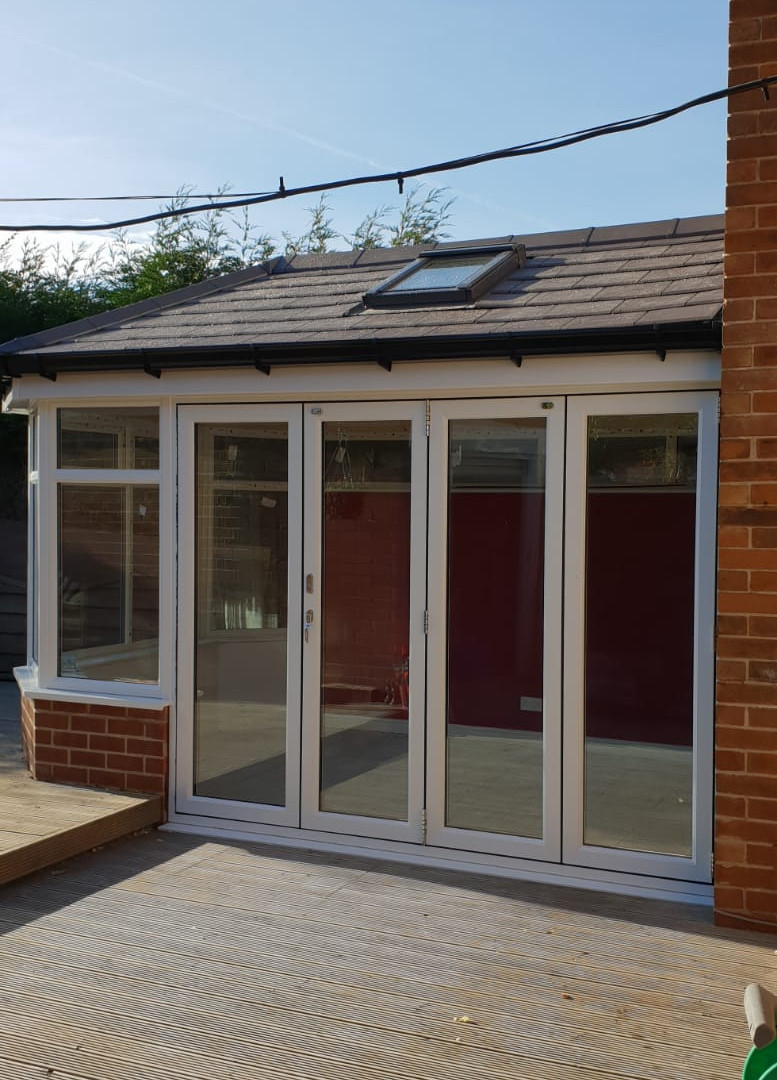 Conservatory with solid lightweight roof