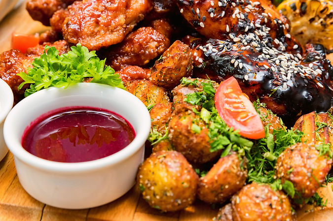 barbecue-chicken-with-vegetables-on-wood