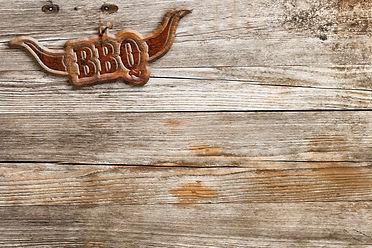 bbq-sign-hung-on-a-wooden-wall-PYQVJ6A.j