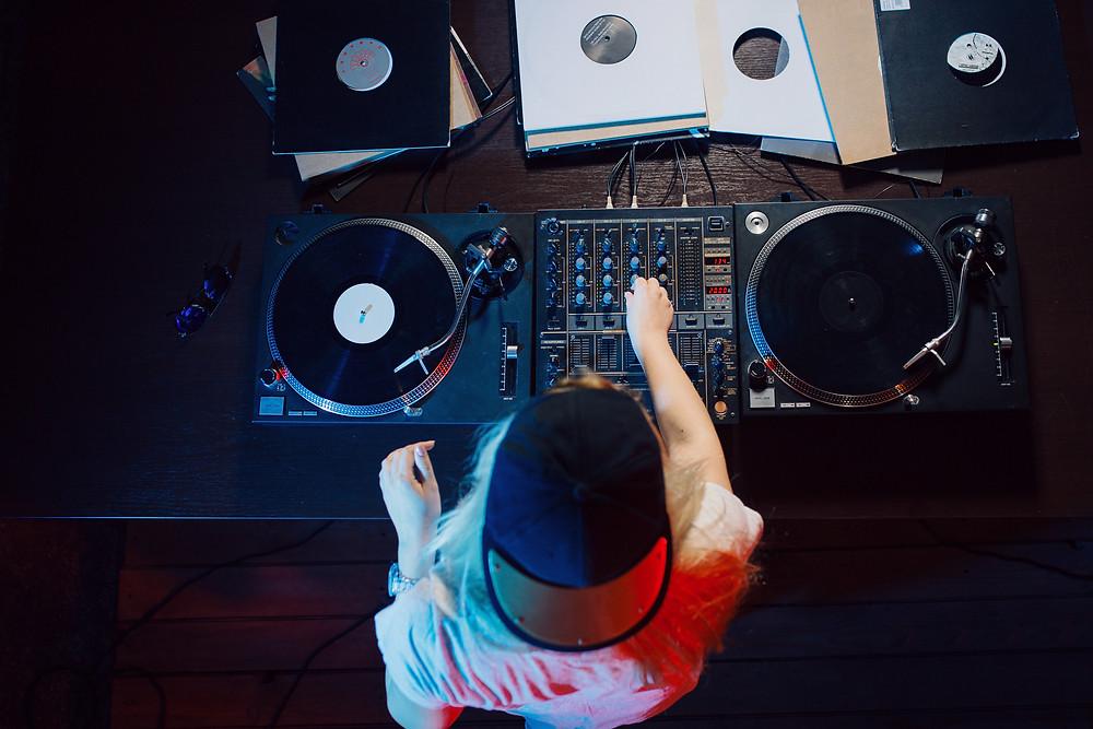 DJ turning knobs on turntables