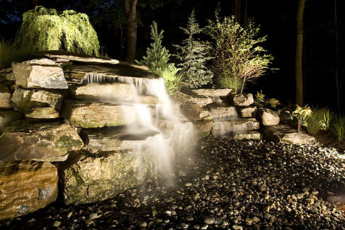 pondless waterfall at night with pond lights