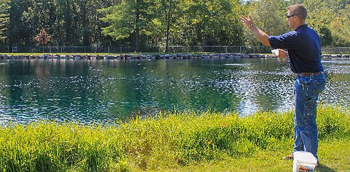 treating a large pond with water clarifier MuckAway