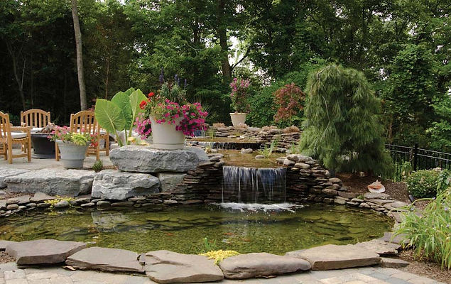 waterfall pond and patio in backyard