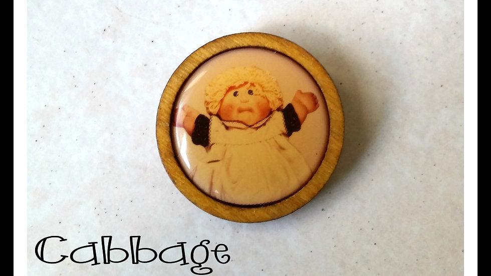Retro Cabbage Patch doll token brooch