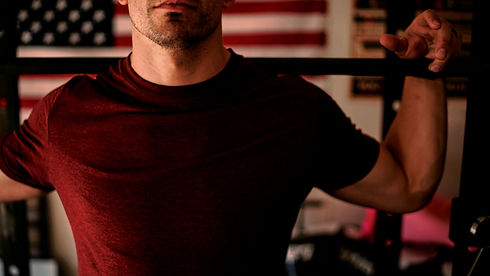 man%20wearing%20red%20crew-neck%20shirt%20carrying%20barbell_edited.jpg