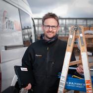 Portrætfoto af tekniker på job