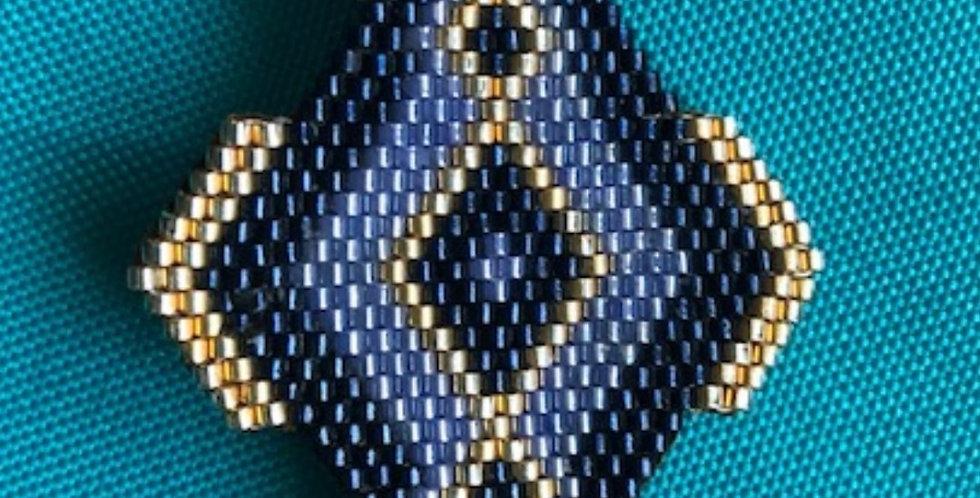 Broche Lala bleu et doré
