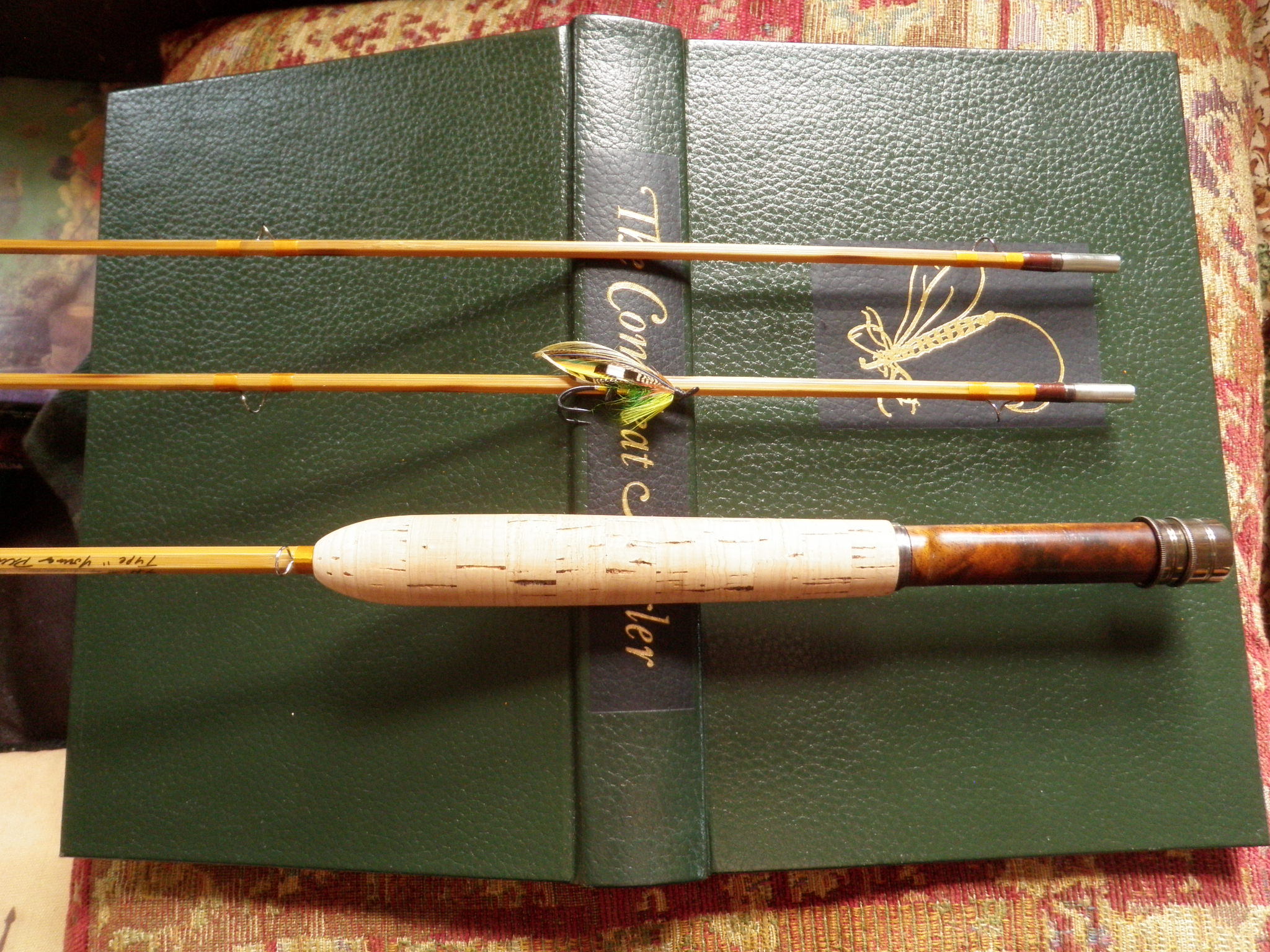 Walton and rod and salmon fly.