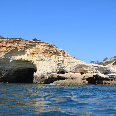 The spectacular Viritantian coastline pockmarked with large caves and smuggler's coves.