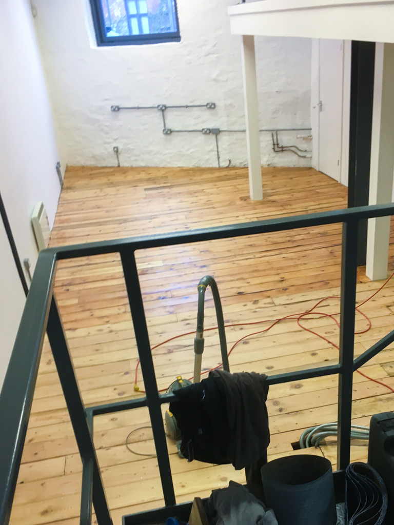 Studio wooden floor after sanding and va