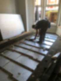 Under floor insulation laying.jpg