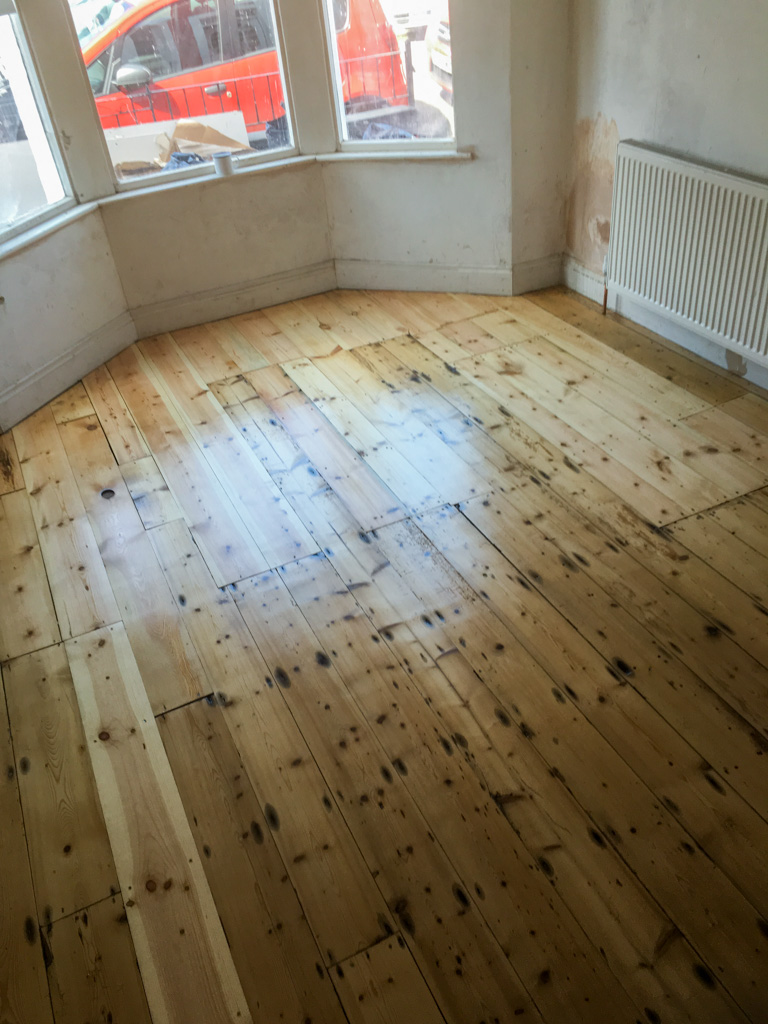 Wood floor after sanding and varnish.jpg