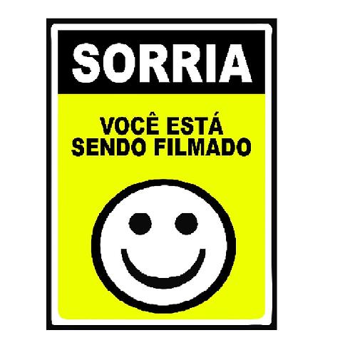 Placa sorria você...