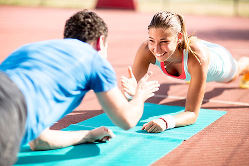 Woman Training With Personal Trainer.jpg