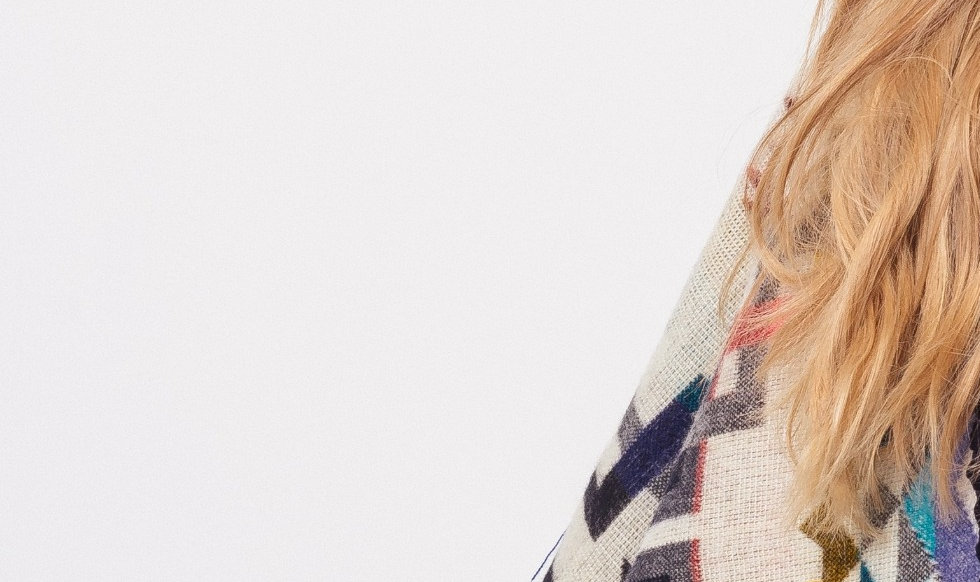Hungarian girl wearing an Alpaca Poncho handmade in Latin America