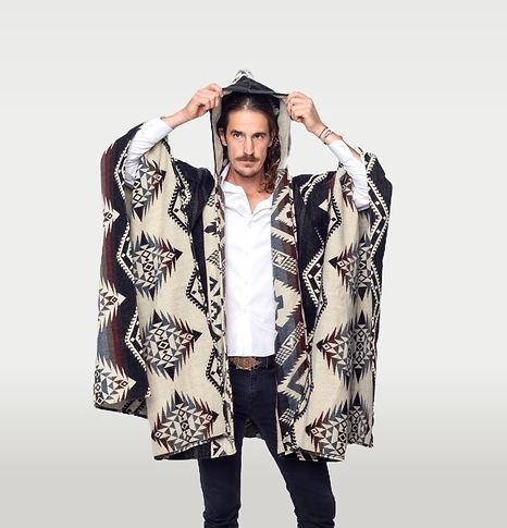 Man wearing a Latin American Poncho handmade by indigenous artisans. Brown Poncho.